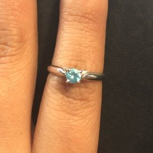 White gold band blue zircon solitaire